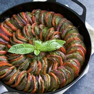 Zucchini tomato pesto bake (similar to ratatouille) is so delicious and easy to make! It's easy to be fancy with this healthy side dish recipe!