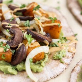 Spicy roasted butternut squash, sautéed onions, mashed avocado, and portobello mushrooms, on a pita, with a chipotle yogurt sauce.