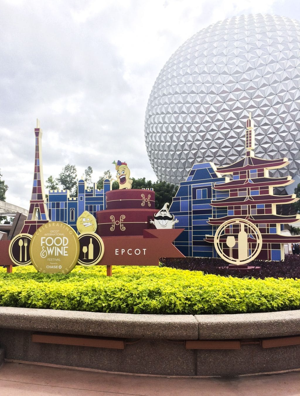 The entrance to the Food & Wine Festival at Epcot next to the large Epcot ball.