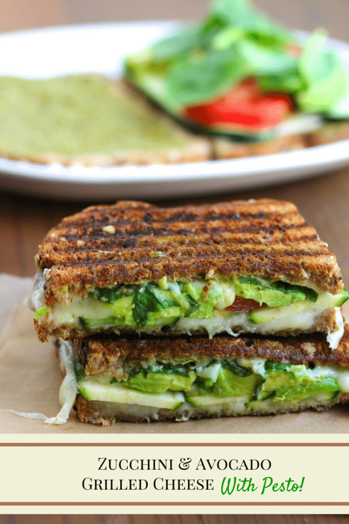 A vegan grilled cheese sandwich cut in half and stacked on top of each other with a white plate behind it on a rustic background.