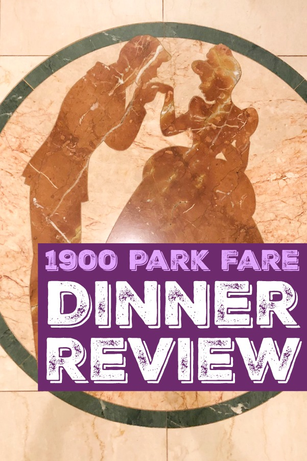 1900 Park Fare dinner review label over a picture of Prince Charming kissing Cinderella's hand on a marble floor.