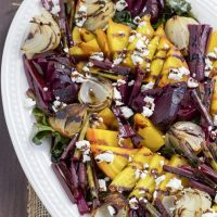 Sweet roasted beet and onion salad is the best side dish for summer! Topped with tangy feta cheese and a rich balsamic drizzle gives it loads of flavor! This salad uses all parts of the beet!