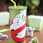 A green Ghostbusters slime smoothie with a crushed M&M's® milk chocolate rim will delight any Ghostbuster fan!