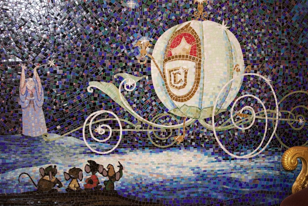 A tile mosaic mural of Cinderella's carriage with the fairy godmother and four little mice.