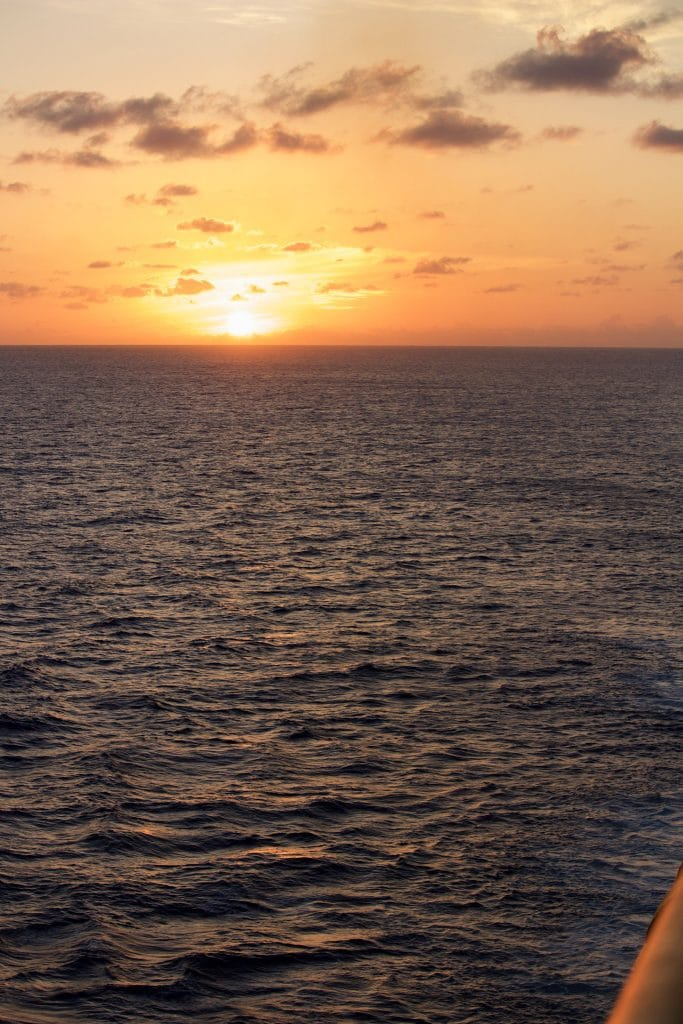 A view of the water and sunset from a verandah on the Disney Fantasy.
