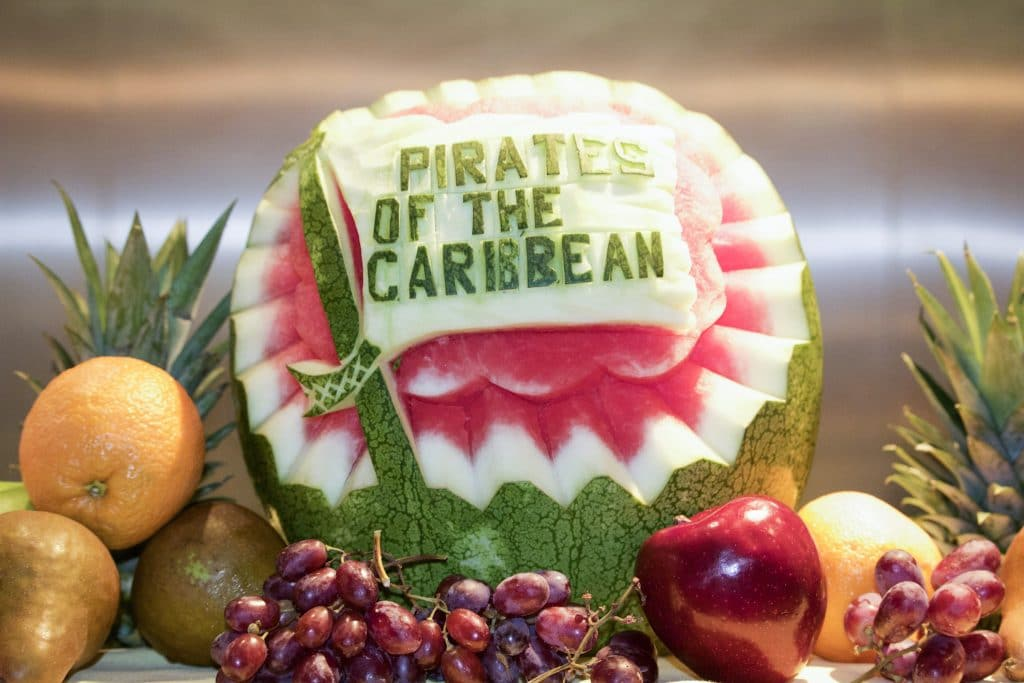 "A watermelon with the words ""pirates of the Caribbean"" carved into the side."