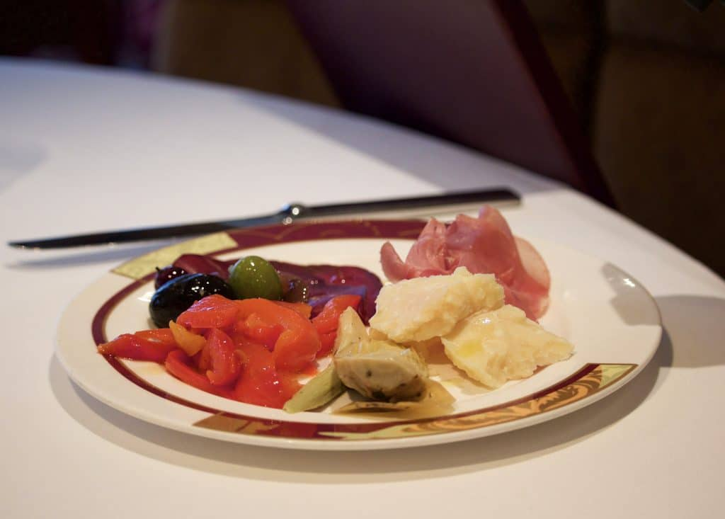 A plate filled with charcuterie at dinner at Palo on the Disney Fantasy.
