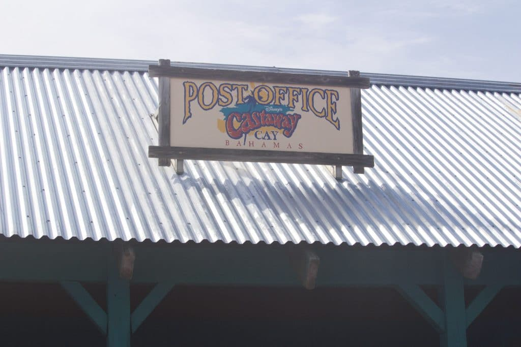 Castaway Cay post office sign on top of the building.