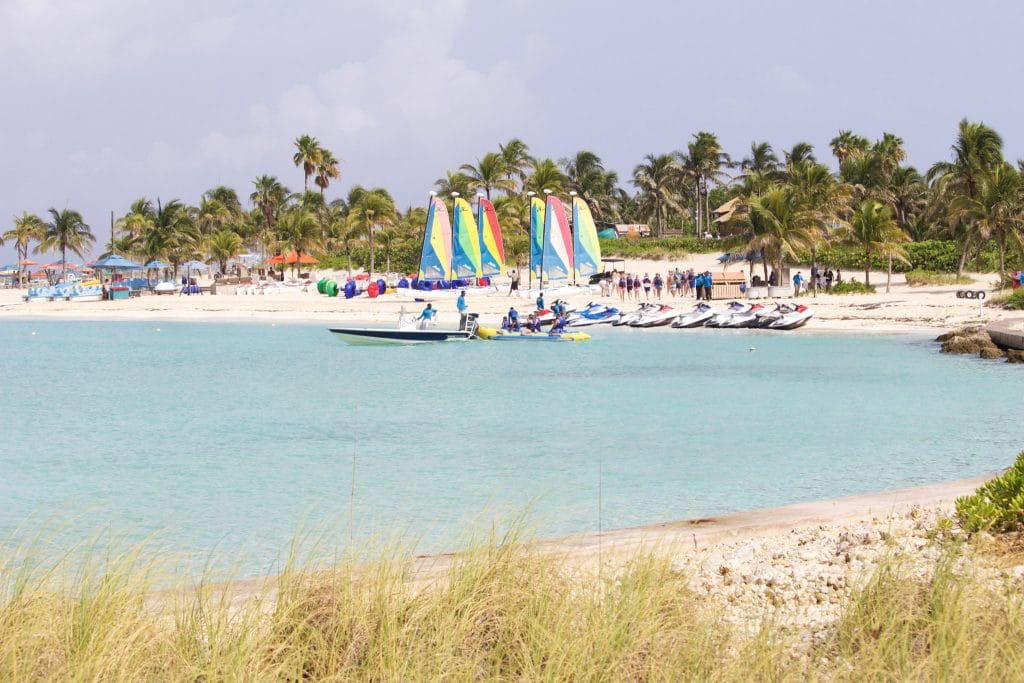 Palm trees, sailboats, jet skis, and the beach at Castaway Cay.