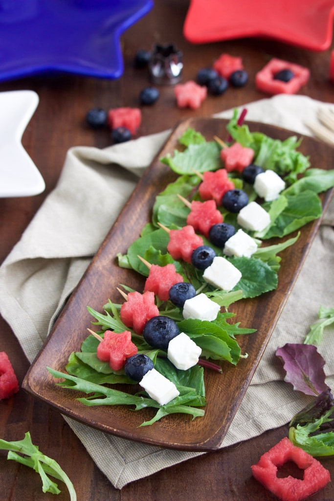 A platter of 4th of July-themed vegan appetizer skewers.