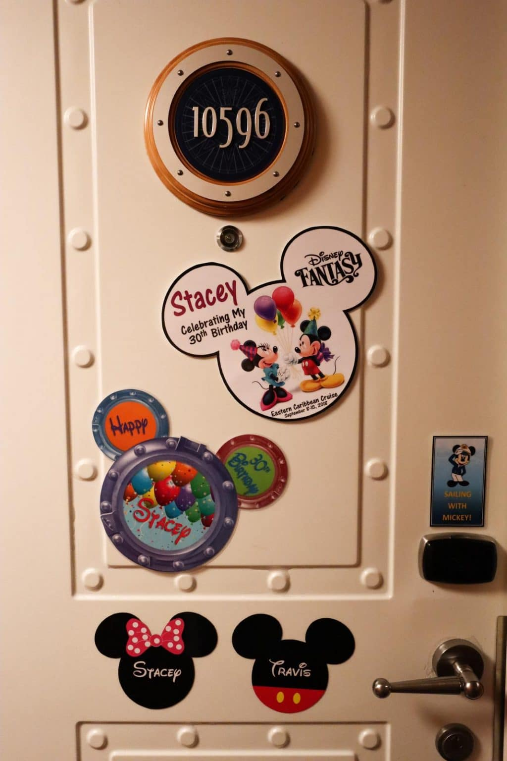 Stateroom #10596 on the Disney Fantasy decorated with Disney-themed magnets.
