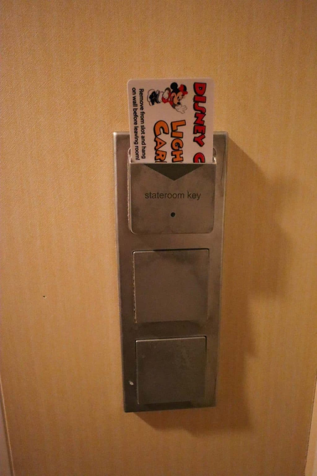 A card sticking in the light switch onboard a Disney cruise.