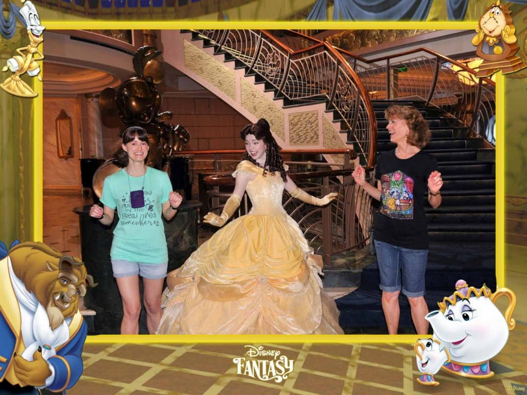 A happy mother and daughter are dancing with Belle at the princess meet and greet on the Disney Fantasy.