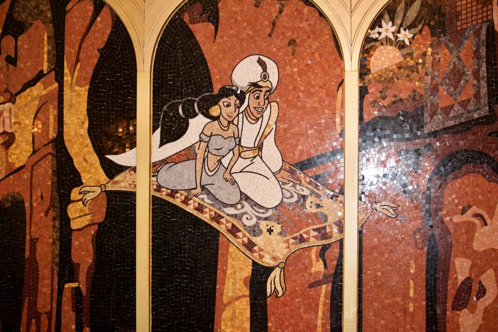 Tile mosaic of Aladdin and Jasmine flying on a magic carpet at the Royal Court restaurant.