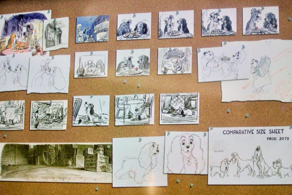 Disney drawings pinned to a cork board.