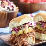 Your friends and family won't believe it when they try this vegan pulled pork recipe and realize that its not really meat! It's that good! Sweet, tangy whiskey pineapple BBQ sauce + slow cooker + pulled jackfruit = heaven!