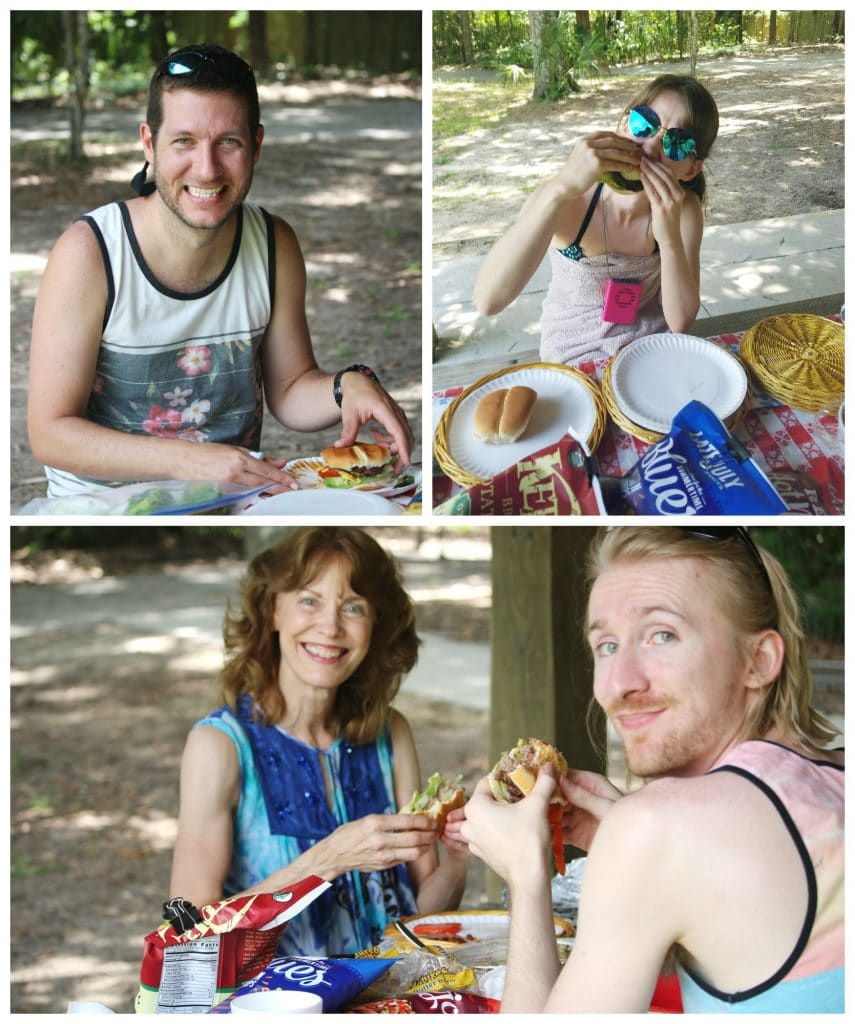 A family eating burgers on a picnic table under the pavilion at Rainbow Springs State Park.