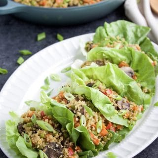 Try this veggie-loaded 30-minute easy quinoa fried rice for a quick and delicious dinner that the whole family will love! You can serve it hot or cold, by itself or in lettuce wraps! Vegan, dairy-free, gluten-free.