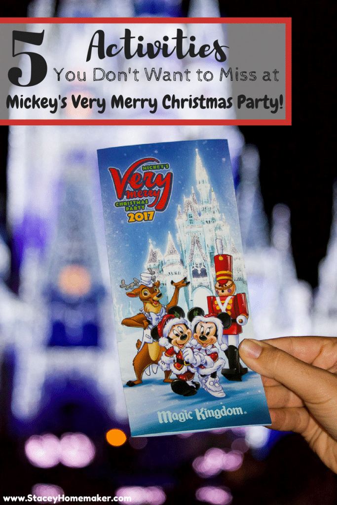 A hand holding a guide map to Mickey's Very Merry Christmas Party 2017 in front of the castle.