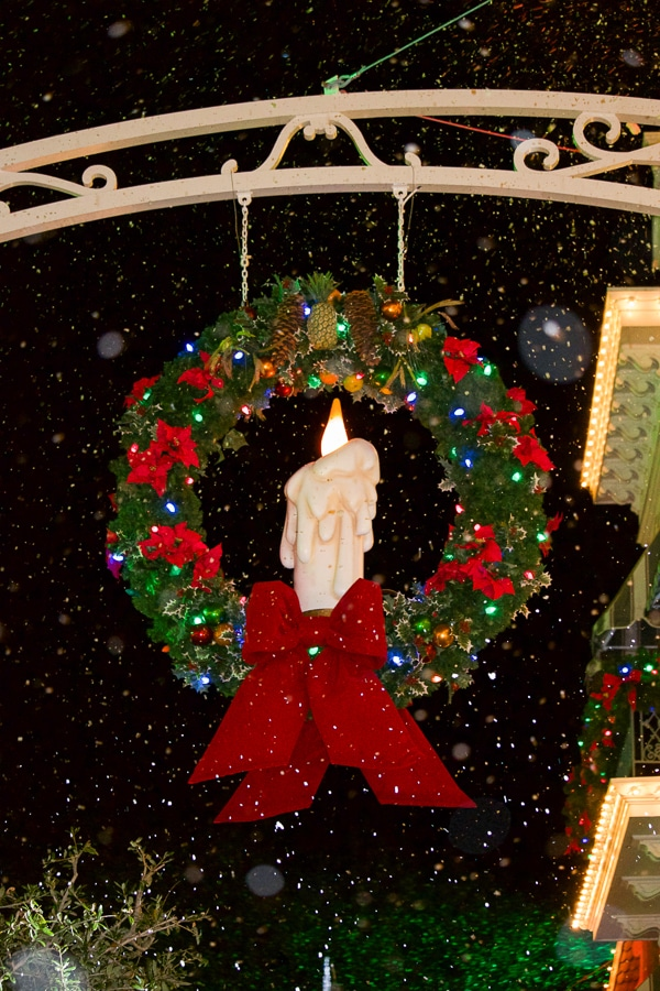 A hanging candle decoration covered in bubble snow on Main Streets USA at the Magic Kingdom.