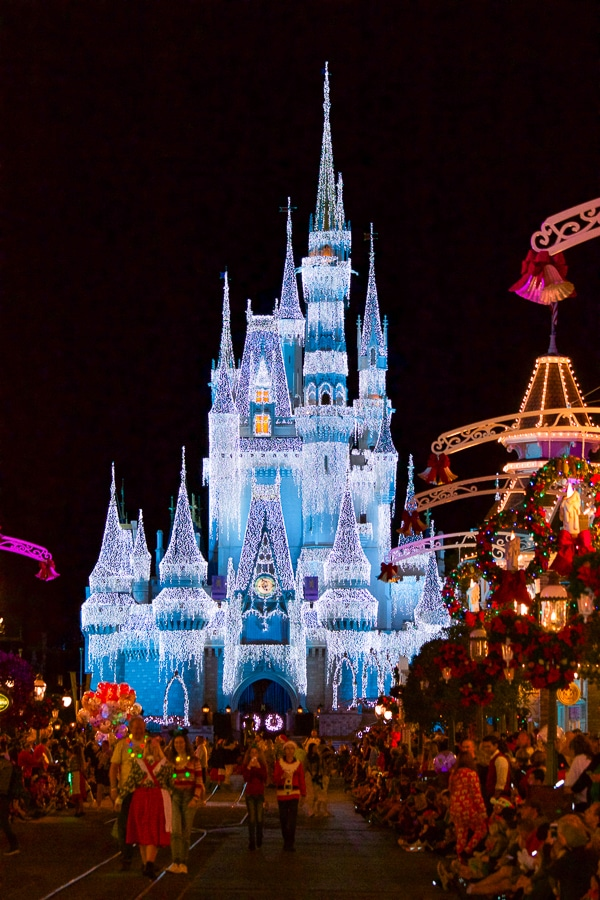 Cinderella Castle lit up at night with lights at Mickey's Very Merry Christmas Party.