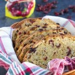 You will love how easy it is to make this delicious no knead bread recipe! Each bite is filled with sweet and tangy cranberries and bright orange flavor. Vegan.