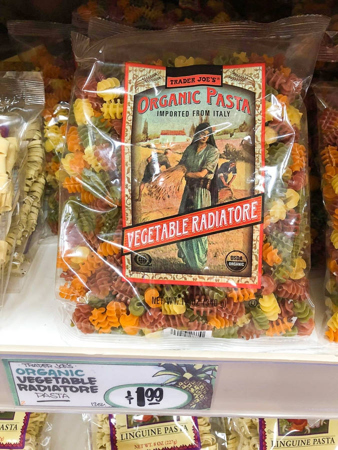 A bag of organic vegetable pasta for $1.99 on the shelf at Trader Joe's.