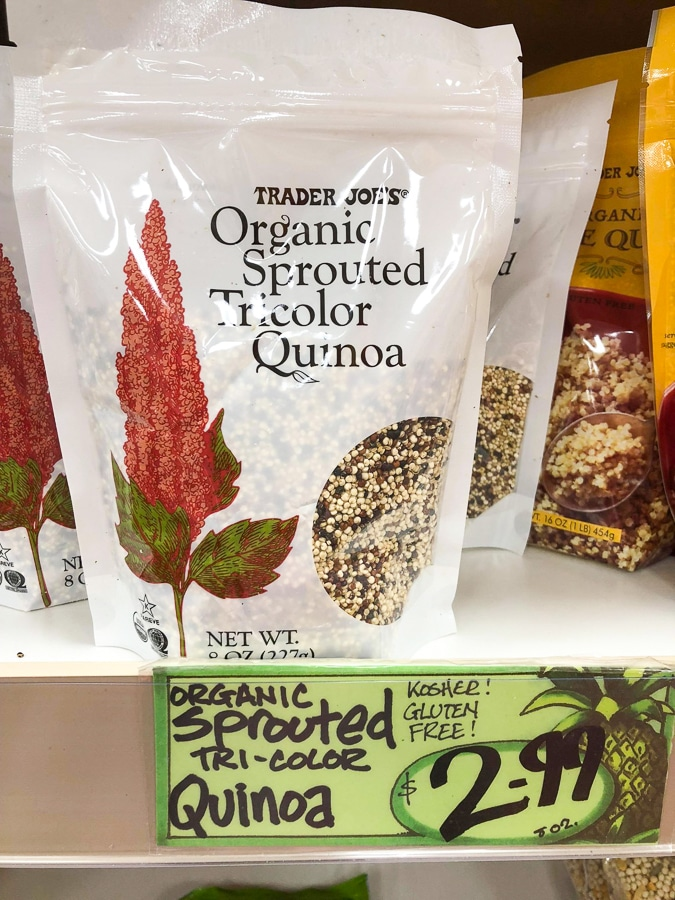 A bag of organic sprouted tricolor quinoa for $2.99 on a shelf at Trader Joe's.