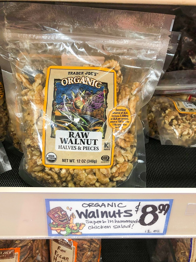 A bag of organic raw walnuts for $8.99 on a shelf at Trader Joe's.