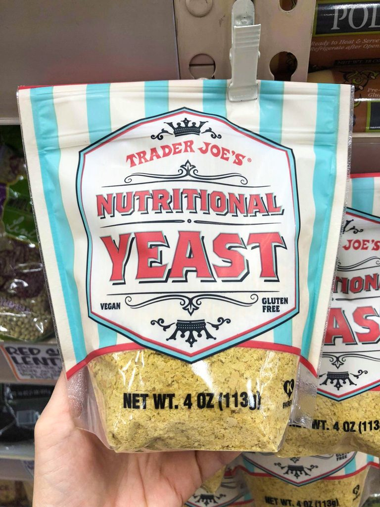 Bag of nutritional yeast hanging from a hook at Trader Joe's.