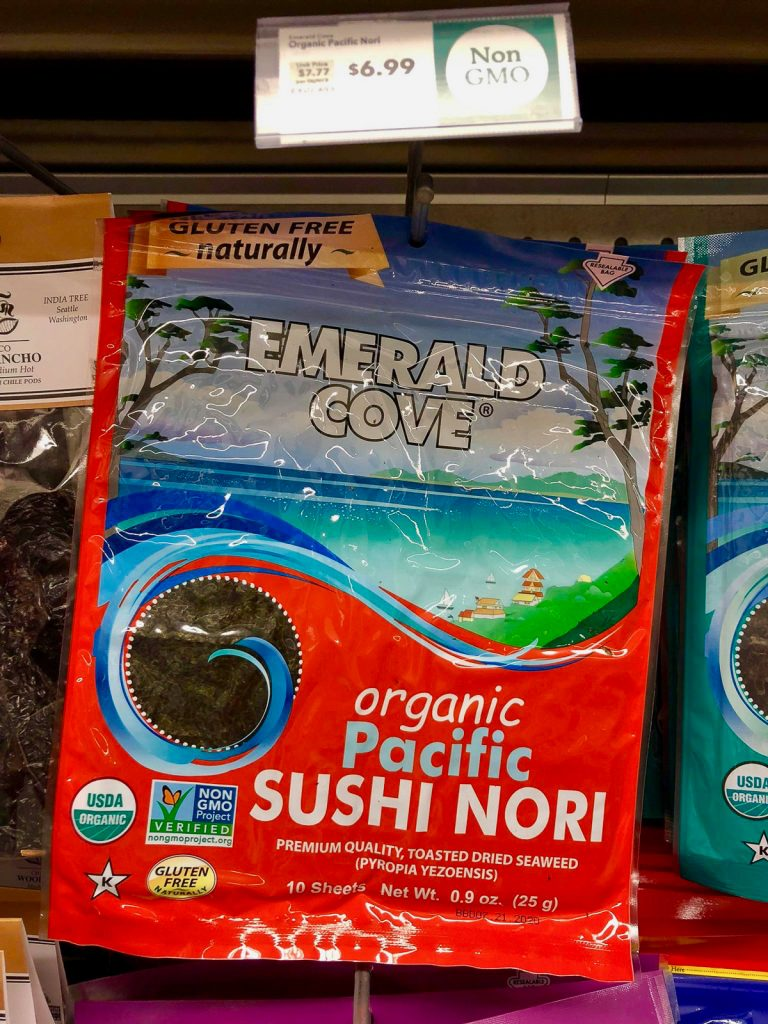 A package of organic nori sheets hanging on a rack at Whole Foods.