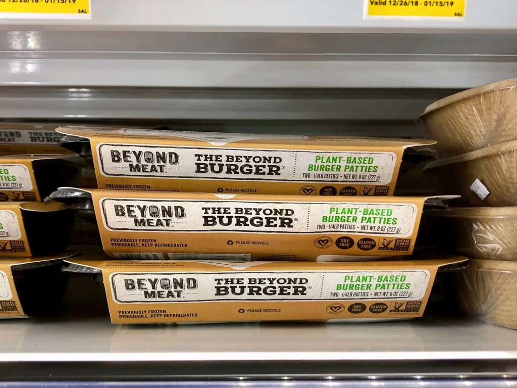 Three packages of Beyond Burgers on a shelf at Whole Foods.