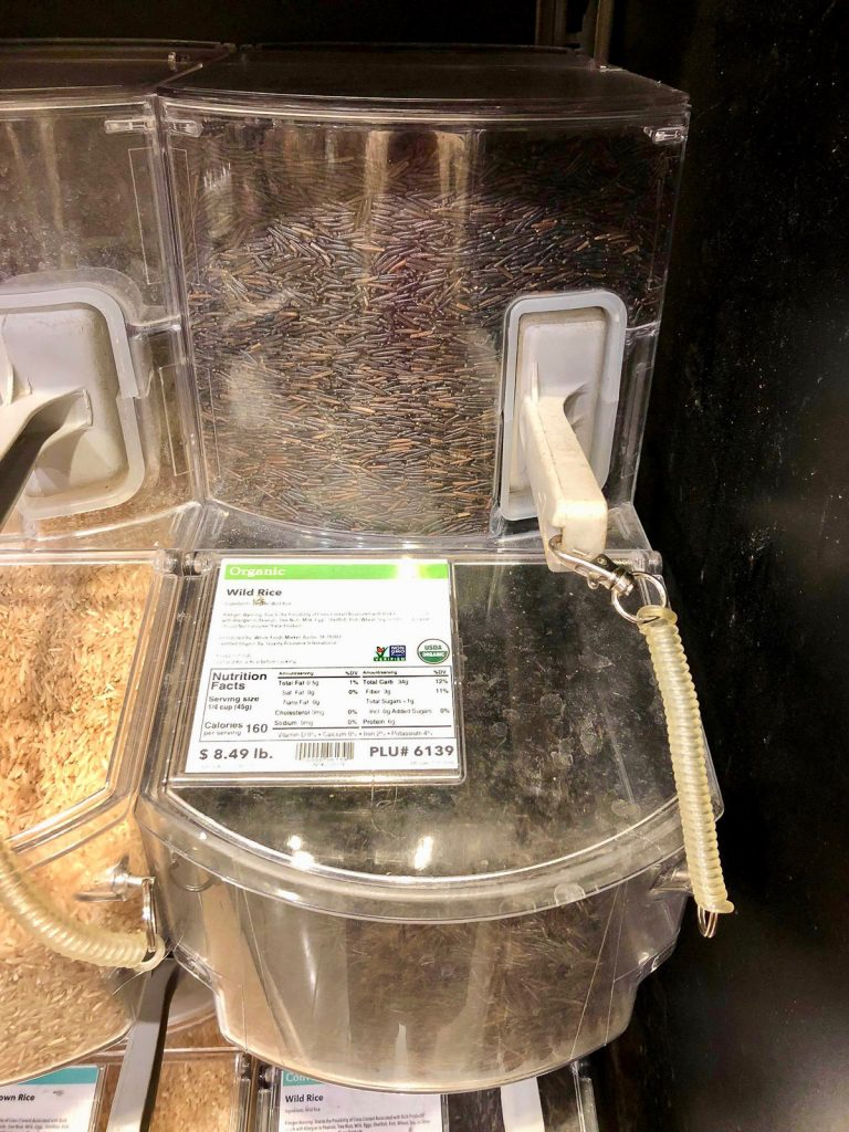 A bulk container of organic wild rice at Whole Foods Market.
