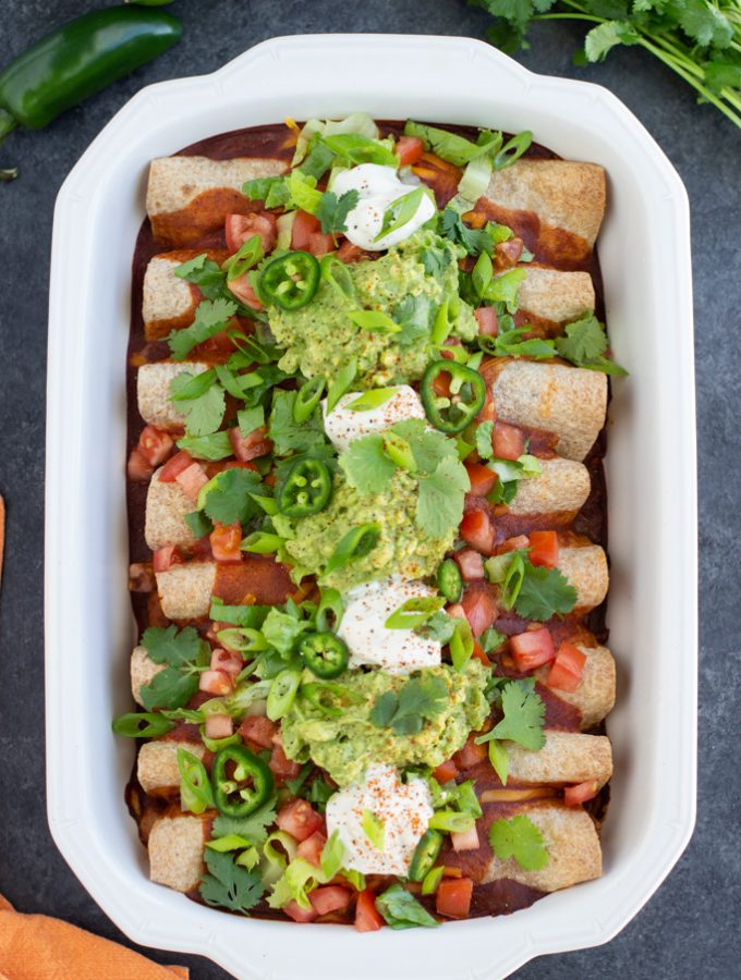 Vegan enchiladas with toppings