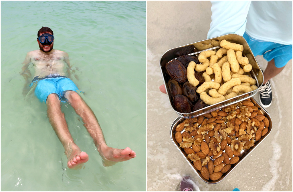 A man snorkeling in the water and eating snacks from a bento box at Caladesi Island.