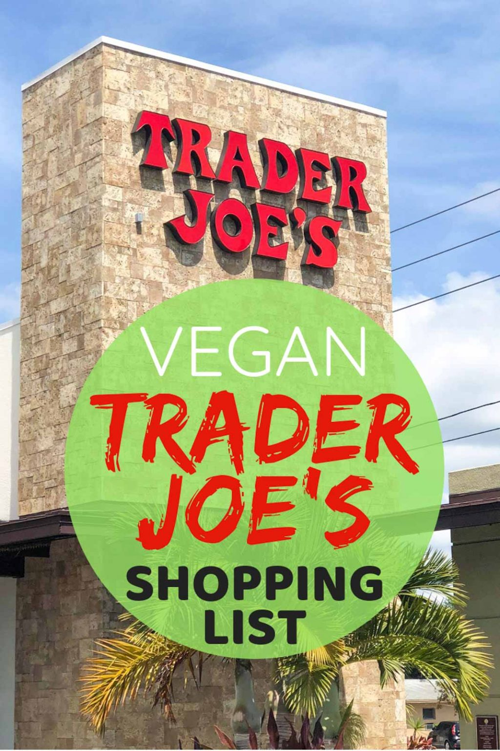"A label that reads, ""Vegan Trader Joe's Grocery List"" in front of the Trader Joe's building."