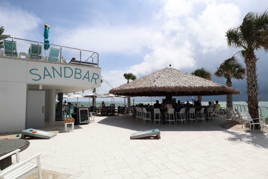 The Sandbar tiki hut and bar overlooking the water at the Opal Sands Resort.