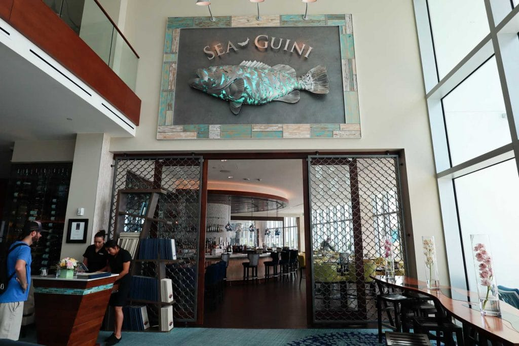 The entrance to Sea-Guini restaurant at Opal Sands on Clearwater beach.