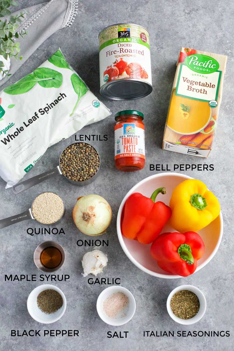 All of the ingredients needed to make the soup laid out on a gray background.