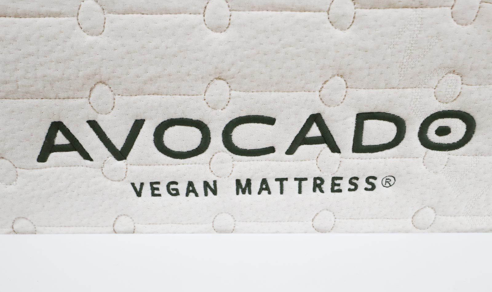 A close up picture of the Avocado Vegan Mattress label on a mattress.