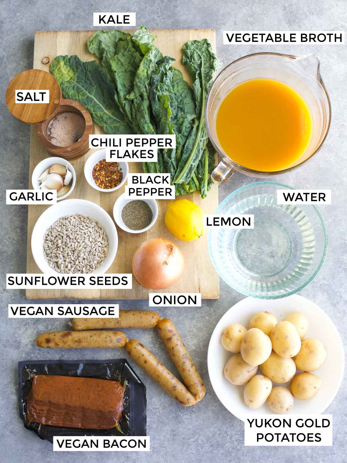 All of the ingredients needed to make the recipe are labeled and laid out on a gray background.